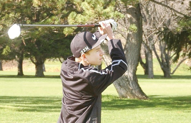 THE DALLES freshman Chase Snodgrass follows through on a chip attempt on the second hole at The Dalles Country Club. Thursday in Pendleton, Snodgrass and his teammates scored a 336 to claim fourth place.