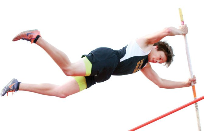 THE DALLES pole vault standout Mark Johnson flies through the air in varsity action at Wahtonka earlier this season. Friday at the 26th annual Wilson Invitational in Portland, the senior vaulted to a height of 12 feet 6 inches to notch second place. Both teams combined for 12 top-3 finishes, including four wins.