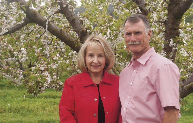 LONGTIME THE DALLES orchardists Dan and Kay Ericksen are honored by their industry as this year's King Bing and Queen Anne.