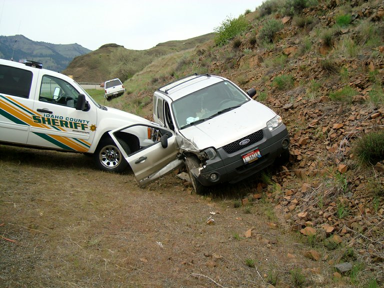 ICSO Deputy Mike Brewster braced his patrol vehicle against the Wilson's Ford Escape to keep it from rolling onto its side.