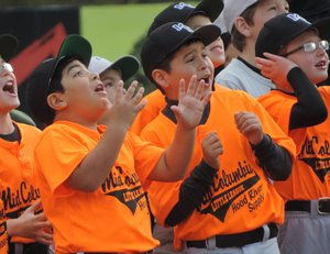 , Players from Hood River Supply reacting to a fireworks display put on by the Hood River Lions.