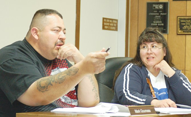 Mabton Councilman Mark Gourneau discusses the need for a kennel size description as part of the city's new dog ordinance during Tuesday night's city council study session. The city is proposing to limit the number of dogs households can have within city limits, as well as the number of dogs per kennel. Also pictured is Councilwoman Sophia Sotelo, who suggests the number of dogs be less than four per Mabton home as the city works to conquer its canine population explosion. The proposed Mabton dog ordinance is still under review by the council.