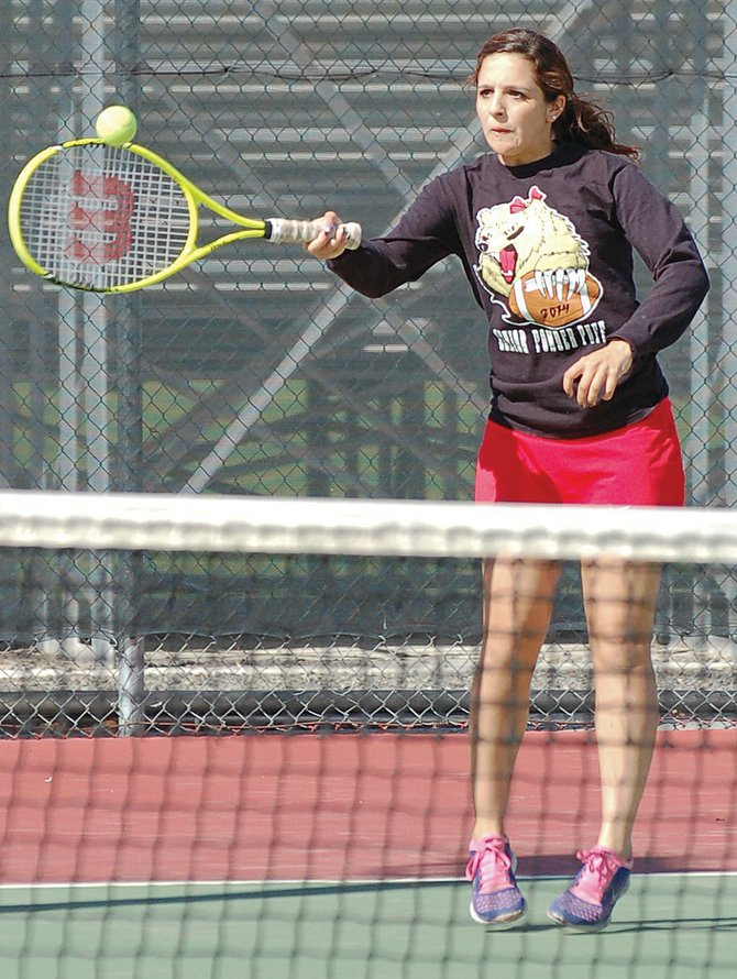 Sydnee Hernandez shows intense concentration to return the ball in a doubles loss to Eastmont Tuesday afternoon. Hernandez and Mattie Meyers lost the match 6-1, 6-1.