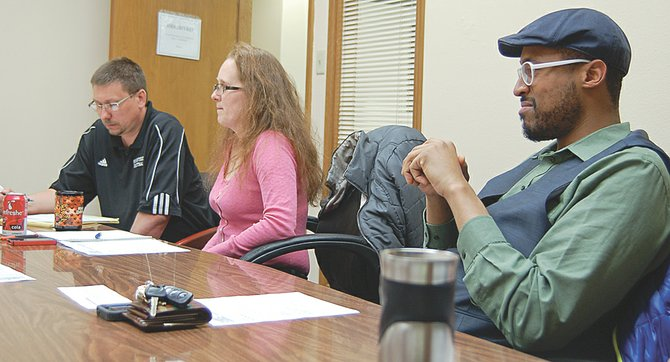 Members of the Sunnyside Arts Commission (L-R) Spencer Martin, DeLeesa Restucci and Bruce Walker, listen to creative discussions at last night's inaugural meeting of the commission. The group, made up of citizens, artists and school representatives, discussed a wide range of ideas for improving access to art in the city.