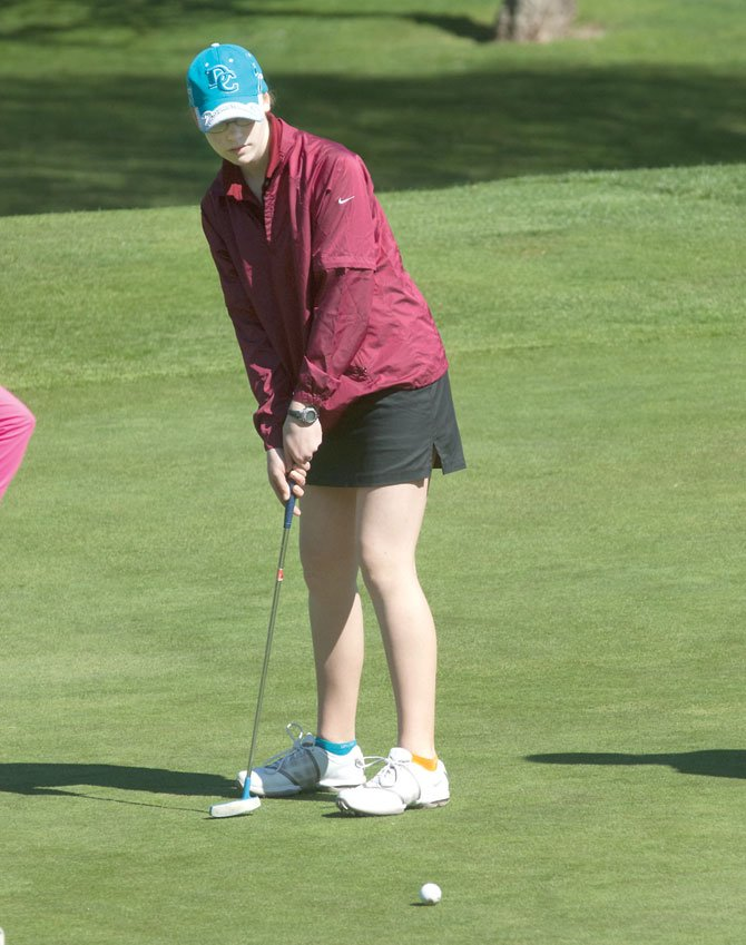THE DALLES golfer Rebecca Stiles measures up her putt shot on the 14th hole at the TD Invitational this season. Stiles and the Eagle Indians surged ahead with a 383 to finish in second place at Prineville Country Club.