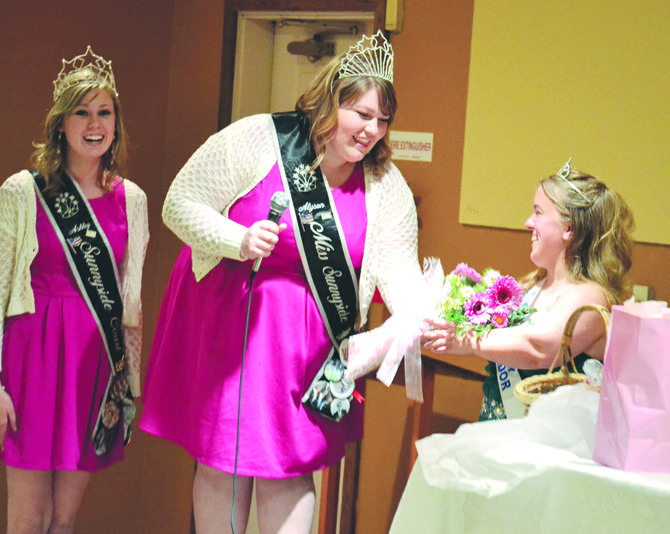 Yakima Valley Dairy Ambassador Katie Hutchins (right) is given a warm send-off at last night's banquet by the Miss Sunnyside Court, including Miss Sunnyside Alyson Spidle (center) and Princess Ashley Davis.