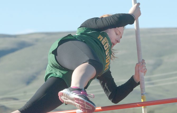 SWC senior track athlete Katherine Popchock flies over the bar in her try at pole vault.