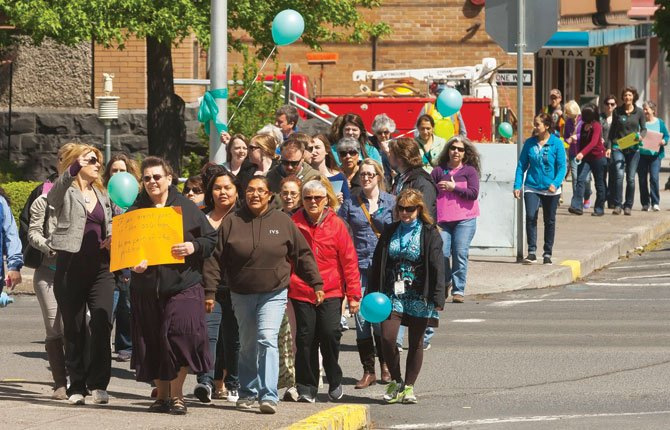 THE 10,000 STEPS Toward Healing walk April 22 drew a crowd to downtown The Dalles. Its goal is to raise awareness of sexual violence within the community. People are asked to wear the color teal in honor of Sexual Violence Awareness month.