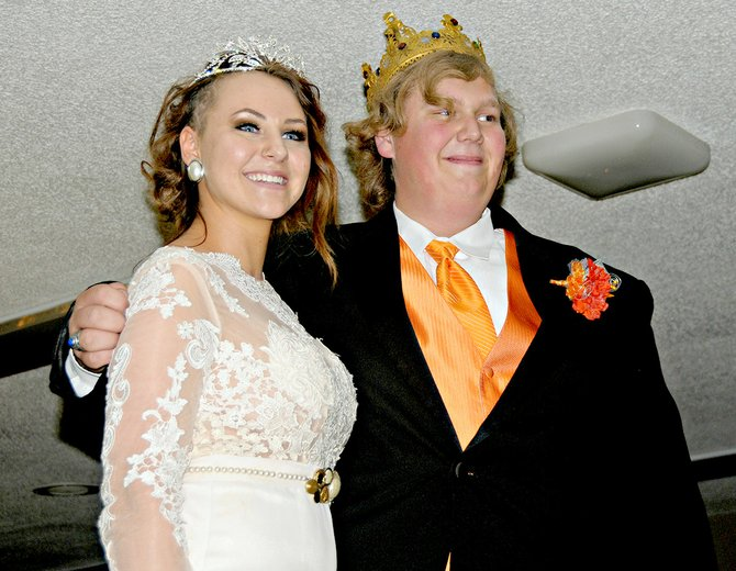 Grangeville High School prom queen and king 2014, seniors Delanie Adams and Joey Jones, were crowned Saturday night, April 26, at the Elks Lodge. The royalty honor is voted on by classmates. Adams ordered her dress on-line then tea-dyed it and embellished it herself with vintage accessories including her grandmother's pearls. She is the daughter of Jeff and Trish Adams and Jones is the son of Dave Jones, all of Grangeville.