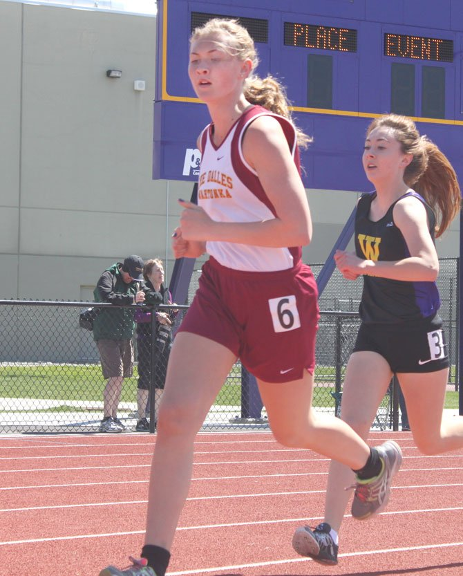TD athlete Caela Dunagan turns the corner in Saturday's Kiwanis Invite in Hermiston.                         Contributed photo