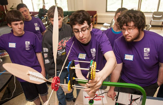 HIGH SCHOOL students compete in teams to build a working wind turbine at the 2013 Wind Challenge.