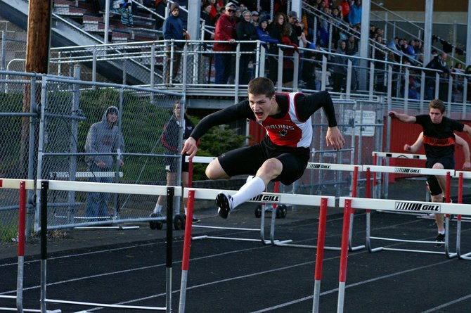 Nathan Bell of CHS powers his way to victory in the 110 hurdles.