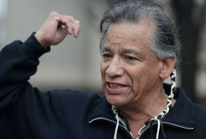 Robert Roche, an Apache Native American, says that Native Americans find the use of Chief Wahoo demeaning before a baseball game between the Minnesota Twins and the Cleveland Indians, Friday, April 4, in Cleveland.