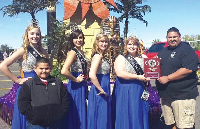 "The Miss Sunnyside community float, ""Egyptian Treasures,"" was presented the Mayor's Award at the Granger Cherry Festival Parade last Saturday. The Granger event is traditionally the kick-off to the start of a busy parade season for Sunnyside's goodwill ambassadors. Here, Miss Sunnyside Alyson Spidle (second from right) receives the Mayor's Award from a Granger Lions Club member. Also pictured are (L-R) Miss Sunnyside Court Princesses Leah Diddens, Tiana Perez and Ashley Davis."