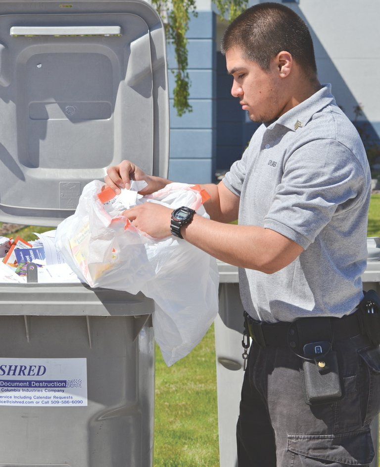Sunnyside Police Explorer Josue Bustamante was busy last Saturday along with other explorers in helping residents dispose of documents and prescription medications during a 'shred and med' event at the Law and Justice Center.