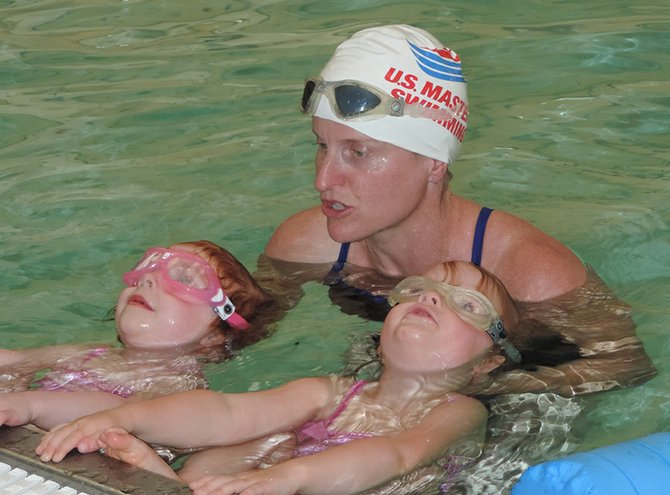 Wily loves teaching swimming to young charges such as 4-year-old Eloise Sperry and Tabor Henry, both of White Salmon.