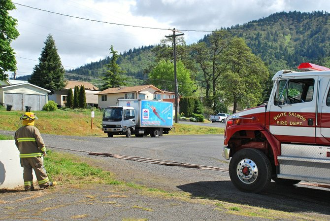 The area surrounding Church Street in White Salmon was closed Monday morning after a hazardous material spill from a Pool and Spabox truck. The driver of the truck was transported to Skyline Hospital and treated for inhalation of Muriatic Acid, which can cause respiratory difficulty and skin irritation.