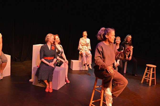 "Ensemble listens as Kathleen Morrow's character wonders about health clubs and the presence of skinny people in such places, and the mysteries of kale, edamame, and other ""health food."" Behind her, from left, are Irene Fields, Lisa Roth, Desiree Amyx-Mackintosh, Julie Jindal and Kim Robichaud."