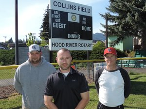 Just over right-centerfield fence is the new scoreboard at Collins Field, donated by Rotary. At center is Rotary president Ben Sheppard. At left is JBO coach Rob Leiblein, and at right is Horizon coach Ty Bofferding.