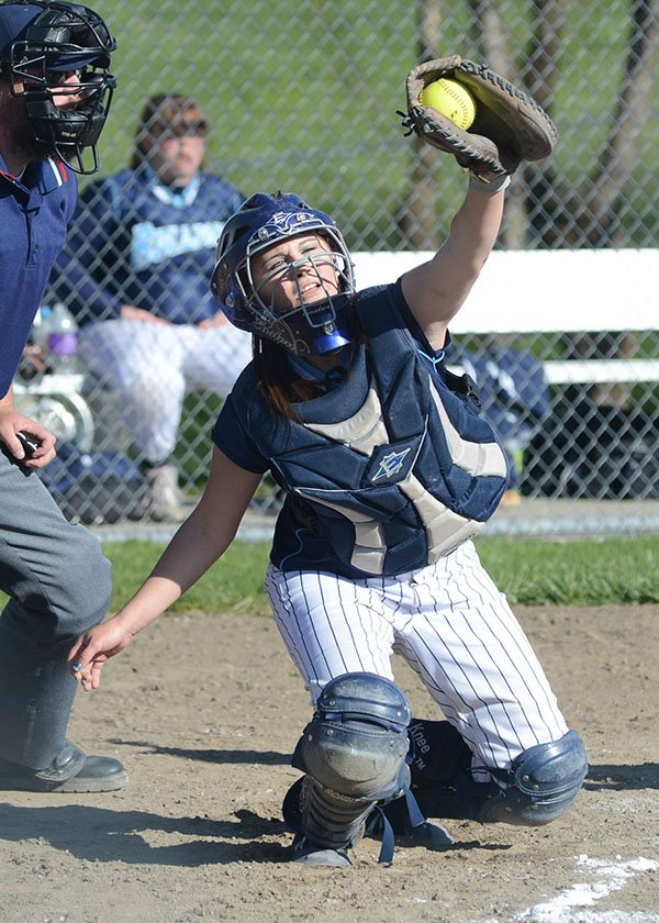 Grangeville senior catcher Morgan Brannan snares an outside pitch on April 29.