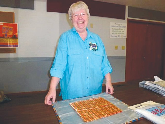 Horizon Quilters Unlimited of Yakima Valley will meet at Immanuel Lutheran Church Hall, located at 300 S. Euclid Rd., in Grandview, on Tuesday, May 13.  The featured speaker will be Jo Mathias of the Tri-Cities Quilter's Guild, who will be demonstrating ice dyeing of fabric. A social hour will be held at 9 a.m. until the beginning of the meeting at 9:30 a.m. Time will be given for show and tell. The meeting will end with a potluck luncheon. Shown at right, last month, Pam Russell of Dayton, demonstrated how to make a portable 