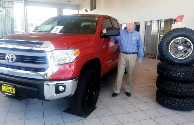 DAVID GRIFFITH, owner of Griffith Motors, poses with a specially equipped Toyota Tundra. Griffith Motors recently won Toyota's President's Award for the fifth time, the fourth consecutive year.