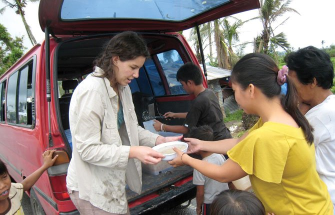 SYDNEY HEGE, a The Dalles Wahtonka High School graduate, distributes food during an internship in The Philippines.	Contributed photo