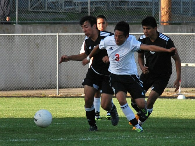 Senior midfielder Chema Gonzalez (no. 3) and two Toledo/-Winlock players pursue a loose ball during a 1A Trico League match on April 29 in White Salmon. The Bruins won their rematch with United, 2-0, to earn a split in the season series.