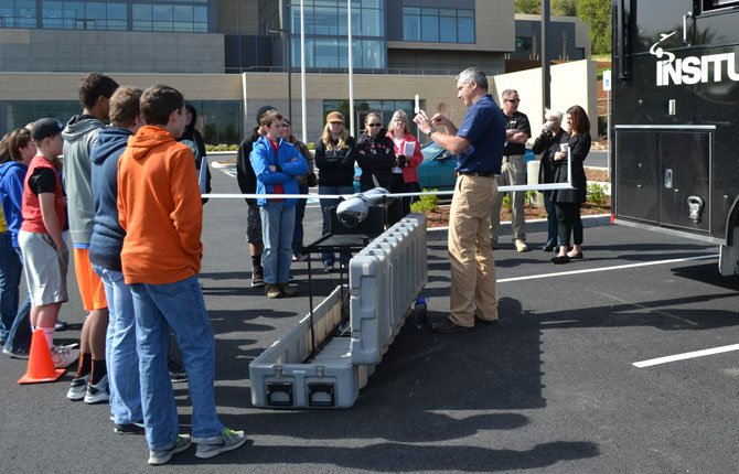 Students from Glenwood and Sherman County learn the ins and outs of Insitu from Rolf Rysdyk with a demonstration ScanEagle and mobile ground control station. Contributed photo