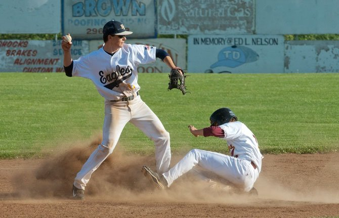 The Dalles sophomore Colin Noonan, right, is out at second as Hood River as Hood River sophomore Patrick Harvey considers, and abandons, trying for a double play.