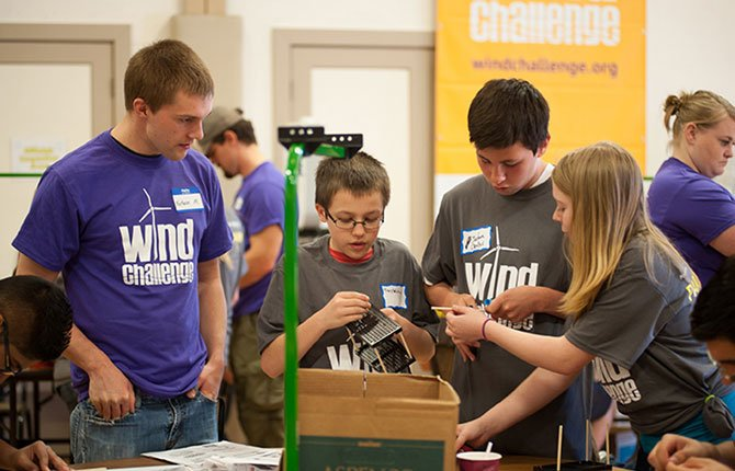 STUDENTS RACE the clock to build the strongest, fastest wind turbines at the Wind Challenge May 3 at The Dalles Civic Auditorium.	Contributed photo