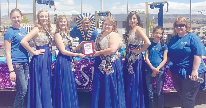 The Sunnyside community float and Miss Sunnyside court last Saturday were awarded the Spirit of the Festival at Wenatchee's Apple Blossom Parade. Pictured with the award are (L-R) Alyson Davis, Sunnyside princesses Leah Diddens and Ashley Davis, float driver Mark Diddens, Miss Sunnyside Alyson Spidle, Princess Tiana Perez, Talia Perez and Diana Blumer-Kilian.