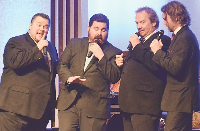 Serenading the hearts of the faithful at last night's concert held at Grandview Church of the Nazarene are (L-R) Paul Secord, Hunter Sparkman, Rick Price and Luke Yates. The Southern Gospel quartet are carrying on the legacy of the Blackwood Brothers, performing as the Blackwood Legacy. The group performed earlier this week at Sunnyside United Methodist Church, as well.