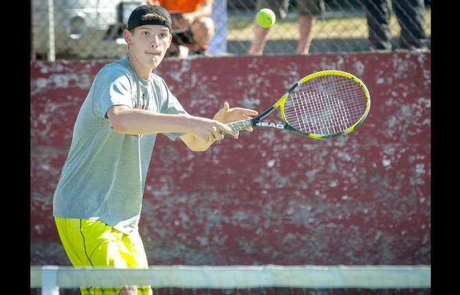 THE DALLES tennis player William Coy returns a shot during a doubles match against Hood River earlier this season. Wednesday afternoon in Pendleton, Coy, playing at No. 2 singles, dropped Pendleton's Henry Holzman in straight sets as part of a 9-0 blanking put out by the Eagle Indians.