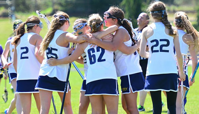 the last game of the season started rough but ended well for the HRV varsity girls lacrosse team. Pictured are the girls coming together after a goal.