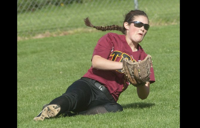 THE DALLES sophomore Ruthie Ford makes a diving catch in a varsity softball game played at 16th Street Ballpark. Friday, Ford slugged a game-winning three-run homerun to lead the Eagle Indians to a 9-6 victory over Hermiston.