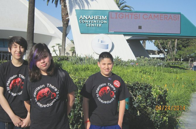 The Robo-Nerds and a Pedal robotics team from Harrison Middle School, made up of (L-R) Margarita Romero, Andrea Barcenas and Ben Rios, stand outside the Anaheim Convention Center during the VEX Robotics World Championships at the end of April.
