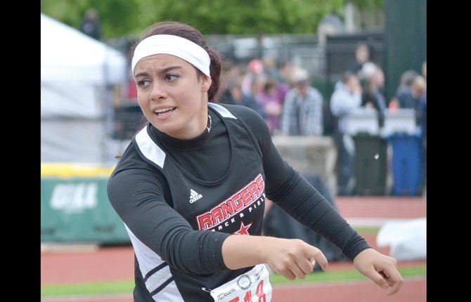 DUFUR junior Taylor Darden follows through on her shotput attempt last year. Saturday in Portland, Darden set a school and PLS Classic meet record in the discus toss with a distance of 120-feet.  Contributed photo