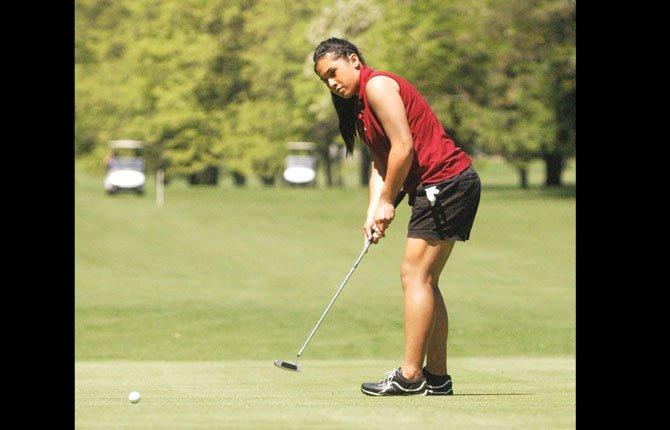 THE DALLES golfer Iliana Telles watches her putt attempt in the opening round of the 5A Columbia River Conference district tournament at The Dalles Country Club. Through one round, Telles carded an 89 for third place.