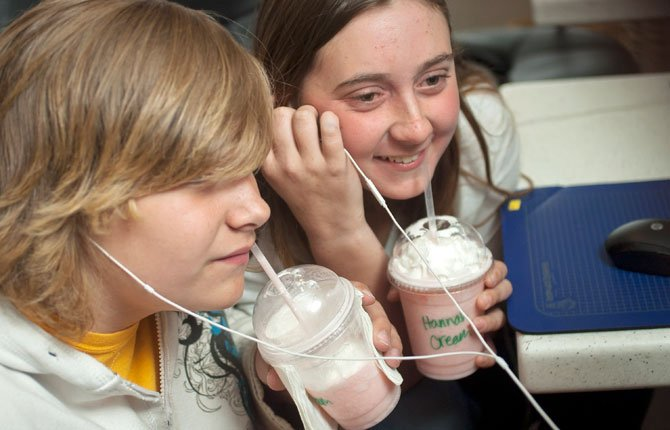 "Hannah Catron, right, and Keil Saling, both 13, share a video on Youtube during the after school program at the Salvation Army ""Loft,"" an upstairs room designated for teen youth programs. The free program, expanded to four days a week this semester, runs Tuesday through Thursday, from 3:30 to 6 p.m. and Friday from 7 to 10 p.m."
