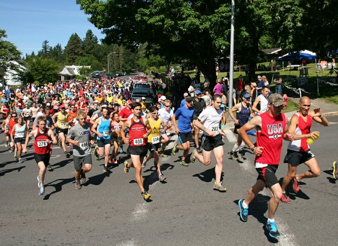 Runners take off at the start of the 2013 Backyard Half Marathon in White Salmon. The half marathon, which is open to runners and hikers alike, returns this year on June 14 and will accept sign-ups until race day.