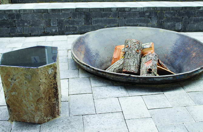 Cool Yakima Valley evenings can be made more enjoyable with a small back yard fire. This metal pit added to a block patio pad is made inviting with a small rock stump seat. There are many types of portable fire pits on the market, or back yard gardeners can opt for a stationary one like the one shown above.