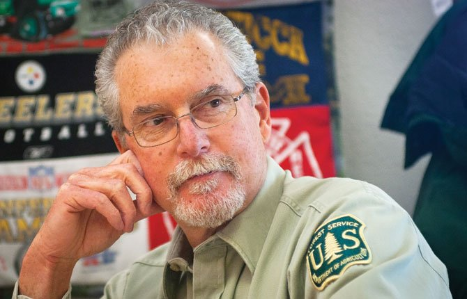 DAN FISSELL talks about competing uses and protection demands on the Mount Hood National Forest. Fissell is the U.S. Forest Service range conservationist on the Barlow Ranger District, headquartered in Dufur.