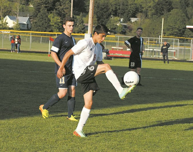 CHS junior right back Rodrigo Cortes gains control of the ball during the Bruins' May 6 Trico League match against Seton Catholic. Cortes scored a first-half  goal and CHS came from behind in the second half to pull out a 3-2 victory.