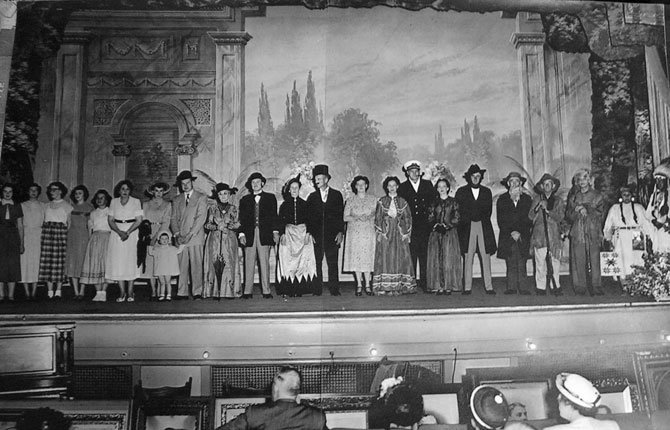 A photo unearthed from the nooks and crannies of The Dalles Civic Auditorium shows performers in a play and the well-dressed audience of the mid-1900s.	Contributed photo