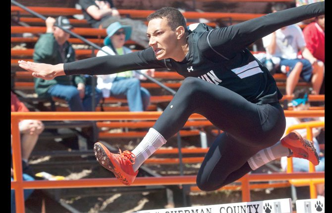 SHERMAN freshman Isaiah Coles glides over the last hurdle in his 110-meter run Saturday in Moro. Coles had a personal record time of 16.91 seconds to grab a district title, beating Horizon's Luke Holste by nearly two seconds.