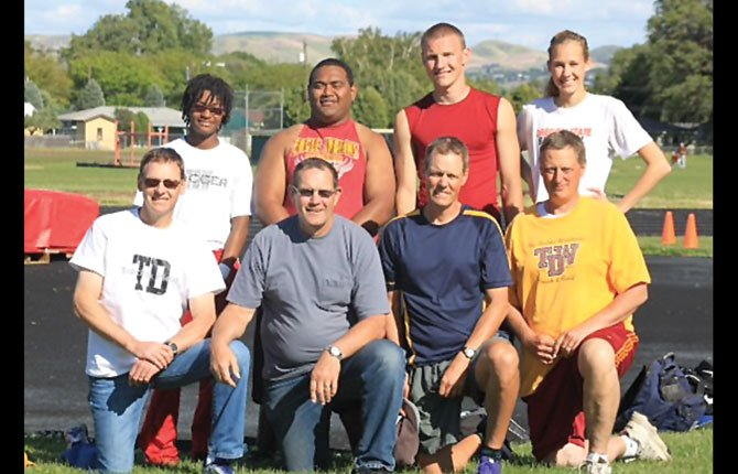 THE DALLES track athletes and their event coaches take time off from practice for a group shot Monday at Wahtonka. The coaches are (bottom, from left), Garth Miller, Dave Cornell, Tom Conklin and Jim Taylor. In the back row, from left, are Yasmin Hill, Lio Tunai, Zach Nerdin and Katie Conklin.