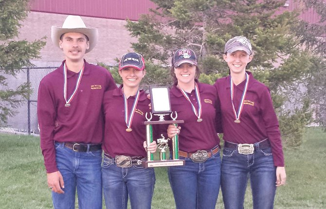 TD equestrians (pictured from left), Jacob Richman, Carsen Cordell, Mackenzie Urness and Hannah Simmons get together for a trophy photo after competing OHSET championship meet. The group placed 19th.