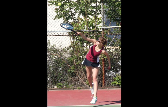TD tennis player Anna Miller raps out a hard service attempt during varsity doubles action this season in The Dalles. In district play this weekend, the Tribe notched six team wins in two days of play in Bend.