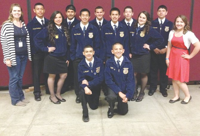 Members of the Mabton High School FFA chapter last week stand together at the State convention. They include (front L-R) Jesus Policarpo and David Jimenez; (middle L-R) Risa Navarro, Michael Jaramillo, Alex Jaramillo and Jessica Vazquez; and (back L-R) Randi Krieg, Joshuah Rodriguez, Miguel Gonzalez, Ty Leyendekker, Joel Chavez, Miguel Navarrete and Anna Gibson.